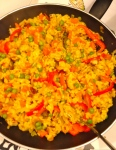 Veggie paella: our spin on this classic Spanish dish...quorn bits, paella rice, peppers, spices, peas etc