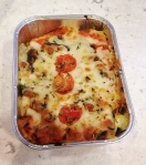 Vegetable Lasagna:  layors of mozzarella cheese, tomato sauce, veggie minced meat, mushrooms, zucchini, baked in the oven. Flavored with wine, garlic, onion, and oregano. non vegan.